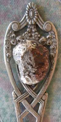 silver and copper amalgamate spoon