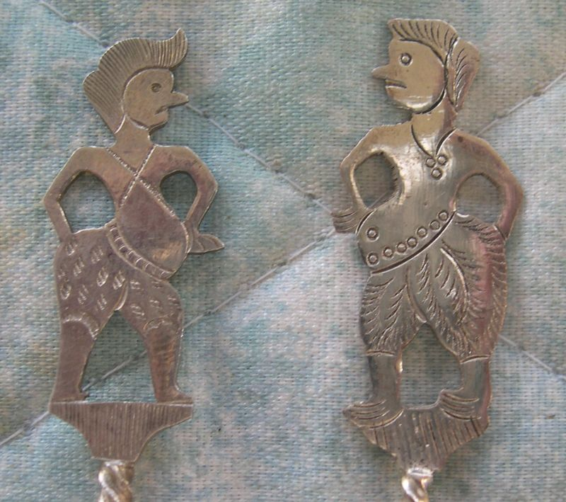 indonesia white man silver wayang puppets